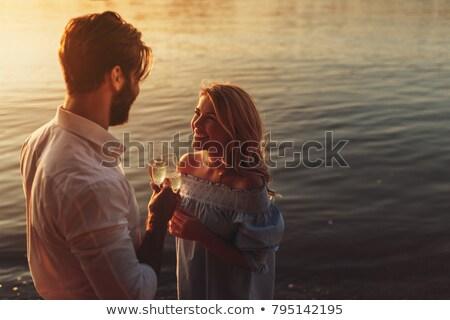 Married Couple Drinking Champagne Stock photo © luminastock