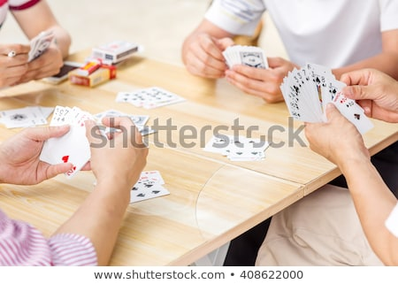 Teen playing cards Stock photo © photography33