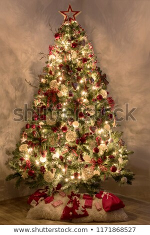 Stock photo: Silver bell in the christmas tree with red ribbon
