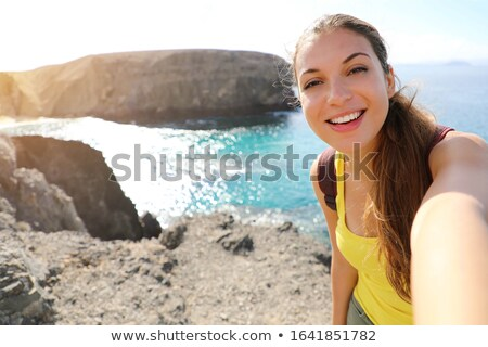 smiling young spanish woman stock photo © arenacreative
