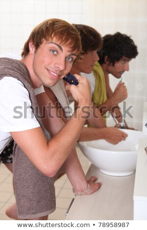 Boys shaving and brushing their teeth Stock photo © photography33