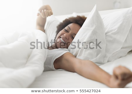 black woman waking up in her bed Stock photo © photography33