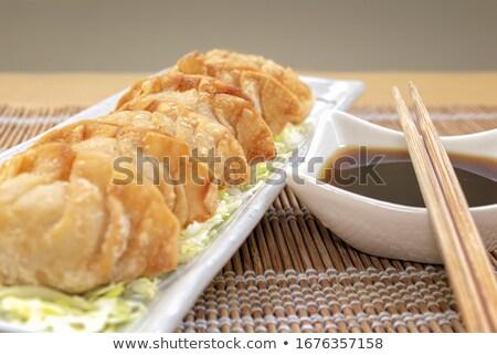 Ropogós finom sült fekete tányér szójaszósz Stock fotó © zhekos
