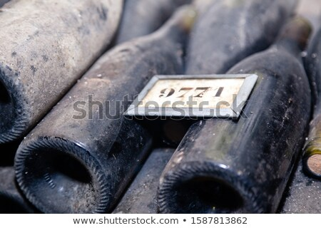Wine bottles in a row as a pattern with cork  Stock photo © lunamarina