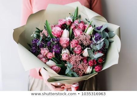 Jóvenes mujer hermosa ramo rosa rosas Foto stock © hasloo