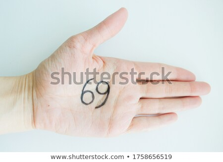 Female hands opening to light and holding zodiac sign for Cancer Stock photo © stevanovicigor