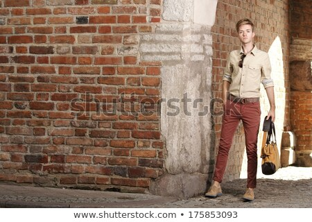 young fashion man with voyage bag outdoor Stock photo © feedough