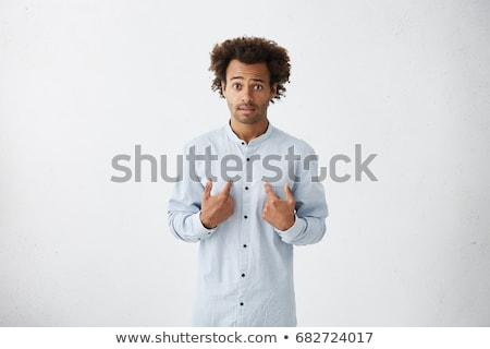 unhappy man pointing at someone stock photo © ichiosea