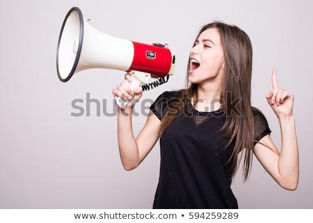 angry businesswoman with megaphone Stock photo © dolgachov