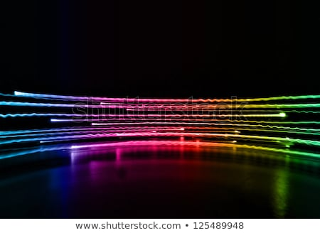 Flashlight with neon light background Stock photo © diabluses