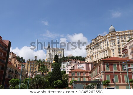 colorful houses green trees and palms in menton stock photo © rglinsky77