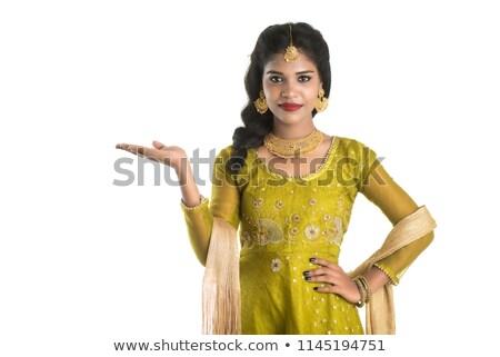 Fiatal indiai nő mutat valami felnőtt Stock fotó © bmonteny