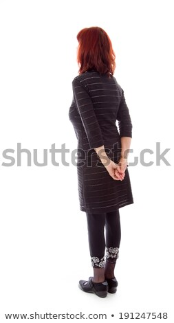 Rear view of a mature woman thinking with her hands behind back Stock photo © bmonteny