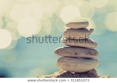 Stones balance, pebbles stack over blue sea Stock photo © EwaStudio