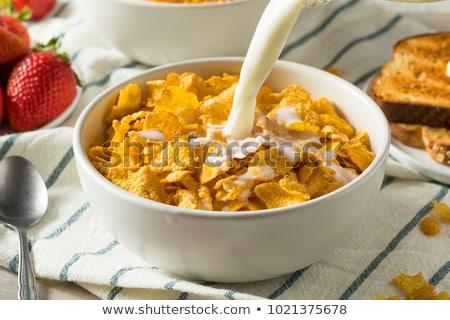 Cornflakes Licht Tabelle Milch Platte Frühstück Stock foto © yelenayemchuk