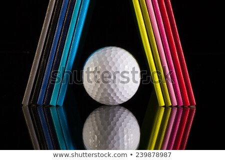 Twelve different colors diaries and golf ball on a glass desk Stock photo © CaptureLight