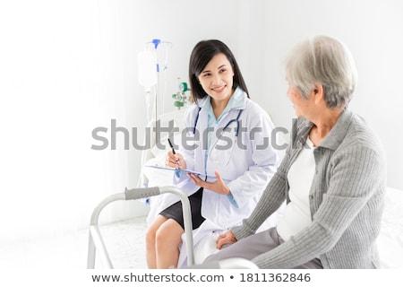 Női orvos promótál boldog mosolyog fiatal Stock fotó © HASLOO