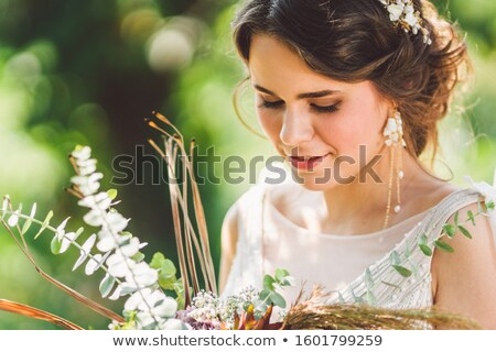 Stock photo: Cute dreamy bride portrait