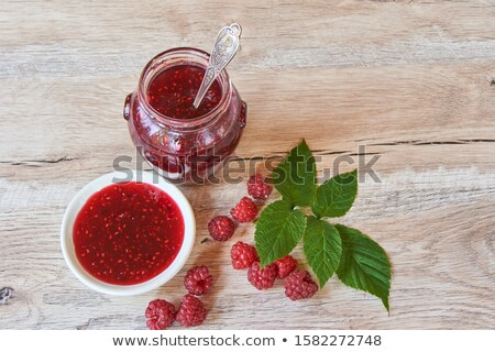 Fresh and tasty raspberries on a wooden table Stock photo © tommyandone