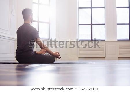 man meditating in yoga lotus position at sunset stock photo © maridav