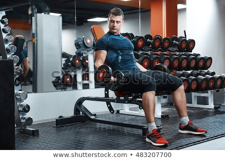 Closeup of a handsome power athletic man bodybuilder doing exercises with dumbbell  Stock photo © master1305