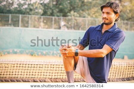 Tennis player warm-up outdoors Stock photo © deandrobot