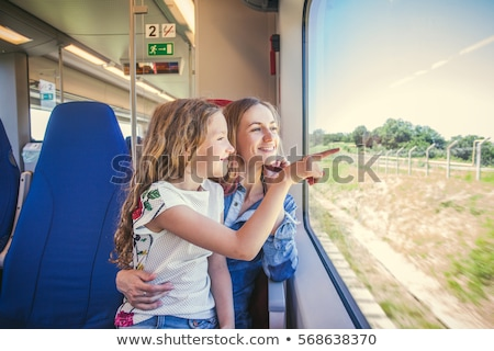 mother and children look from train window Stock photo © Paha_L