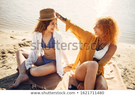 beautiful woman with little girl in white hat near sea stock photo © paha_l