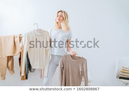woman in dress standing near a house wall stock photo © artfotoss