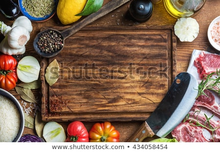 Fresh rosemary on a wooden chopping board Stock photo © ozgur