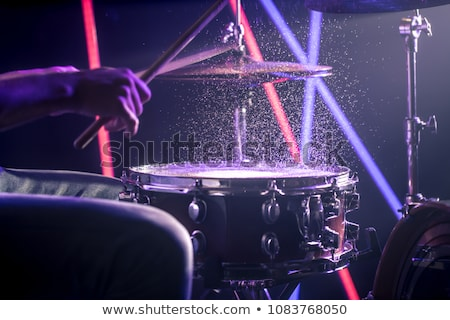close up of male musician playing cymbals Stock photo © dolgachov