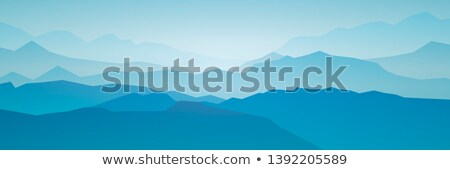 panorama vector illustration of mountain ridges peaks blue green hills forest clouds in the sky stock photo © fosin