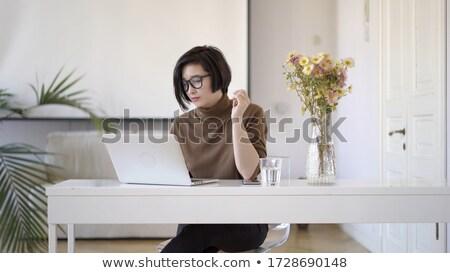 Töprengő nő asztal üveg víz vörös hajú nő Stock fotó © deandrobot