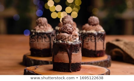 mini chocolate cakes on wooden background stock photo © digifoodstock