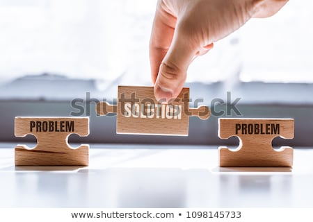 Puzzle mot solution pièces de puzzle construction jouet Photo stock © fuzzbones0