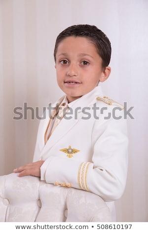 Fiatal srác áll néz komolyan első szent Stock fotó © BigKnell