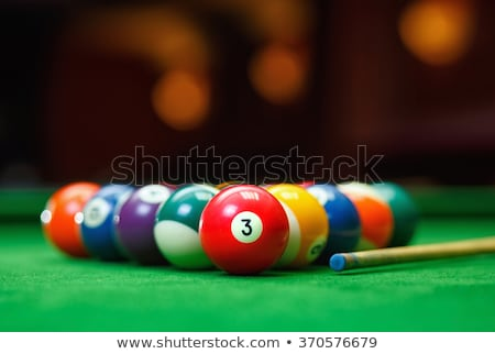 Pool balls on a green pool table Stock photo © avdveen