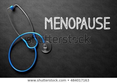 Menopause on Chalkboard. 3D Illustration. Stock photo © tashatuvango