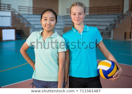 Volleyball player holding ball in court Stock photo © wavebreak_media