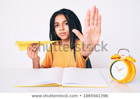 African traveler showing stop hand gesture. Stock photo © RAStudio