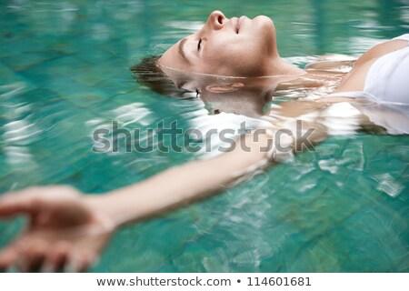Calme femme piscine eau Photo stock © wavebreak_media