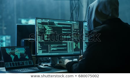 Stok fotoğraf: Hooded Computer Hacker Hacking Network