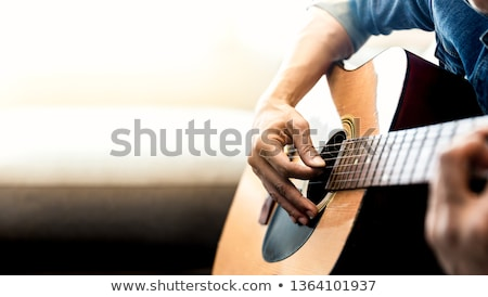 Close up person man's hands on acoustic guitar artist musician Stock photo © manaemedia