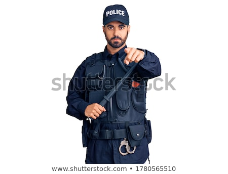 Serious hispanic police officer pointing at you. Stock photo © RAStudio