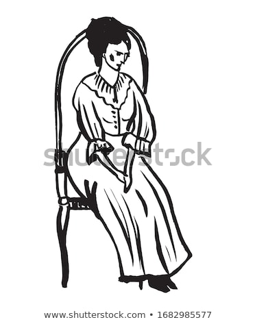 Picture of beautiful woman in black dress sitting in the armchair  Stock photo © Traimak