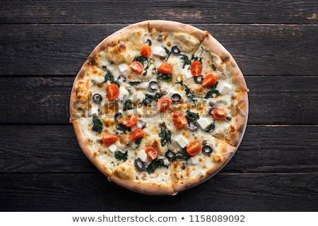 Pepperoni olive nere pizza fatto in casa fresche prosciutto Foto d'archivio © zhekos