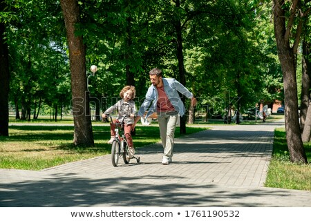 A boy running to his father in the park Stock photo © IS2