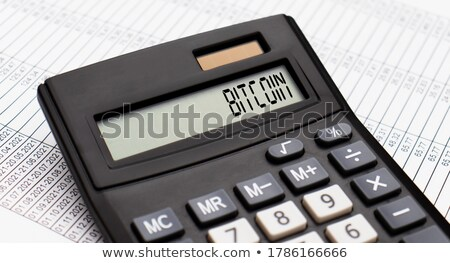 Calculator with the word Bitcoin on the display Stock photo © Zerbor