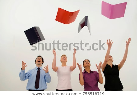 Jubilant business people throw folders Stock photo © IS2