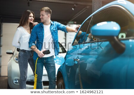 business man working near electric car stock photo © is2